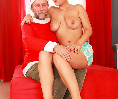 Alexa Bold shows off her big natural tits and shaved pussy on Santas knee