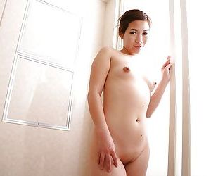 Asian MILF connected with shaved cunt Satoko Suda playing connected with vibrator after shower