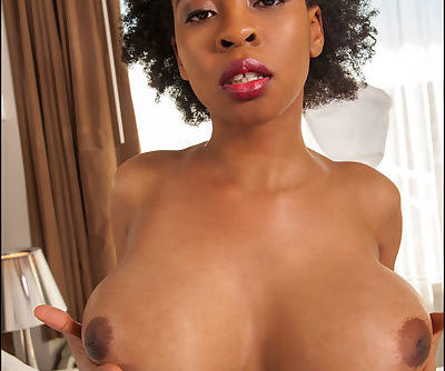 Ravishing ebony babe in glasses uncovering her massive boobs - part 2