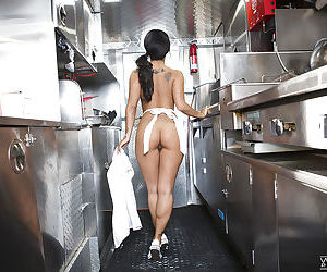 Asian babe Asa Akira drops her denim skirt to reveal her perfect ass