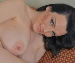 Brunette solo girl Stacy Ray freeing large MILF tits and spread pussy - part 2