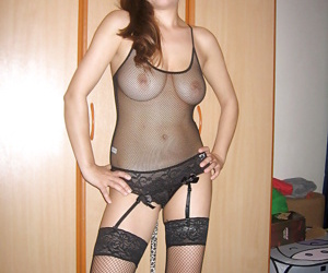 Playful kitty with big tits posing in lingerie and stockings