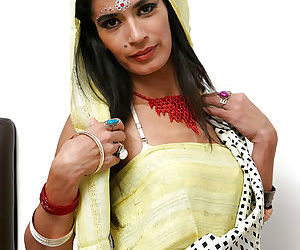 Indian solo model Tamara setting up candles for worship wit her clothes on - part 2