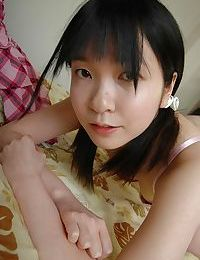 Shy asian teen stripping down and showcasing her gash in close up