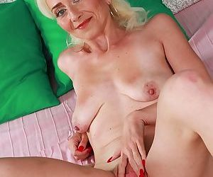 Skinny blonde lady Janotova undressing for masturbation of shaved vagina - part 2