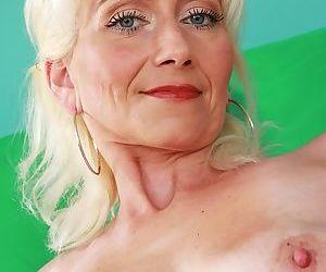 Skinny blonde lady Janotova undressing for masturbation of shaved vagina