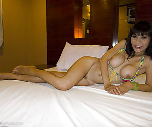 Busty Asian shemale Kie strips off bikini and has ladyboy cunt fucked