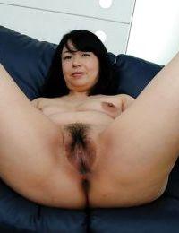 Japanese MILF Norie Shibamura undressing and expanding her bushy underside lips - part 2