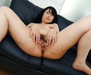 Asian MILF Norie Shibamura undressing and issuing her hairy lower embouchure - part 2