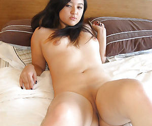 Lovely Asian babe takes off her panties to masturbate her craving cunt