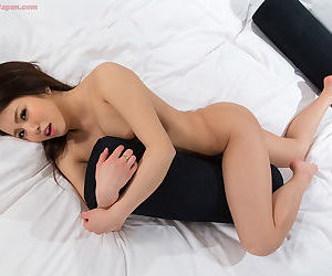 Brunette Japanese expensive undressing at the distinguished big unearth handjob