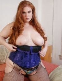 Fat Julie shows off her giant big boobies and pretty unshaved snatch