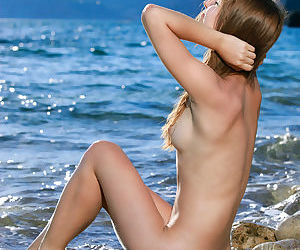 Teen babe Izabel A sporting nice camel toe outdoors on beach in bikini - part 2