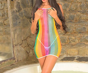 Young brunette Angela Diaz strips off see thru dress and thong to pose nude