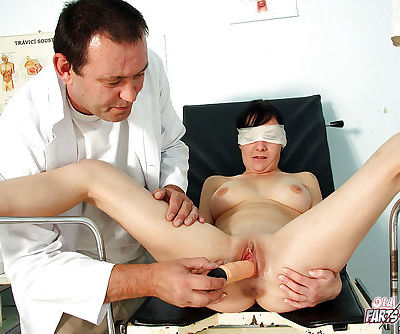 Brunette chick is blindfolded and used for sex by older doctor in exam room - part 2