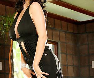 Sexy pornstar brunette Tera Patrick on knees flaunting huge tits in high heels
