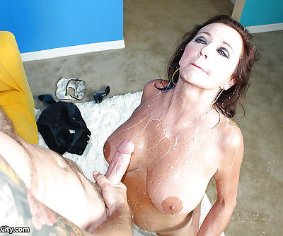 Naughty MILF gives a proper handjob and receives bukkake on her big tits - part 2