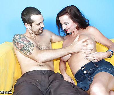 Naughty MILF gives a proper handjob and receives bukkake on her big tits
