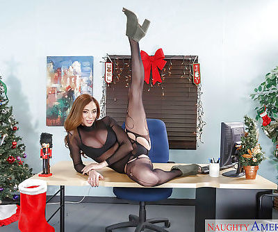 Redhead MILF Ariella Ferrera showing off knockers in sexy hose at Christmas