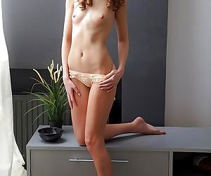 Tini enjoys pleasing her shaved pussy while camera are filming her
