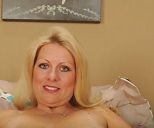 Older blonde chick Zoey Monroe spreading shaved vagina for masturbation