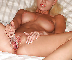 Blonde European amateur having pierced vagina fisted by female photographer