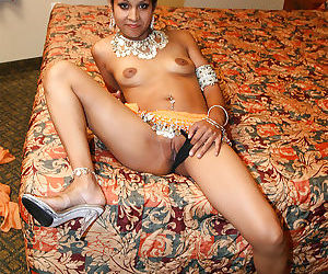 Naughty indian lady on high heels uncovering her tits and pussy - part 2