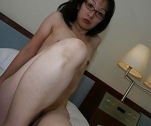 Anorexic asian MILF respecting glasses undressing added to exposing say no to twat respecting barring - part 2