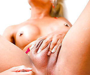 Hung Asian tranny Kai spreading her tight asshole in a bathtub - part 2