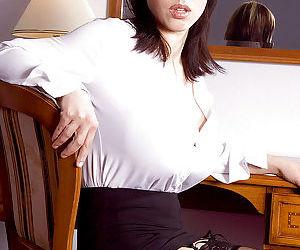 Buxom European solo girl Merilyn Sakova masturbating shaved MILF vagina