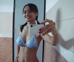 Playful Asian babe Lana Selfshot demonstrating trimmed pussy and fingering