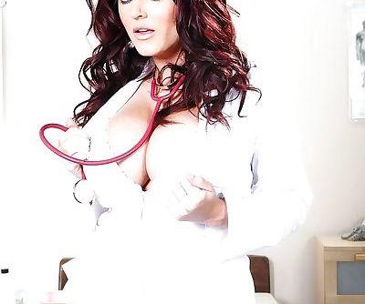 Brunette babe Sophie Dee strutting in over the knee socks and nurse uniform