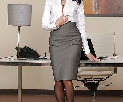 Beautiful babe Breanne Benson takes off her sexy clothes in the office
