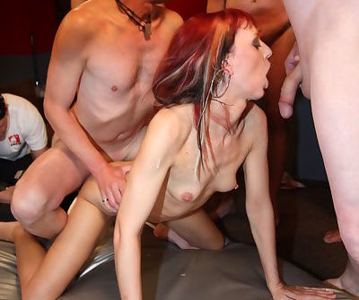 Skinny Euro chick Gina Bang and friend fuck all the guys in gangbang