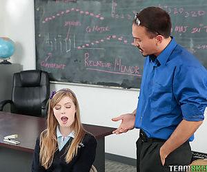 Schoolgirl Dolly Leigh giving her teacher a blowjob in the classroom