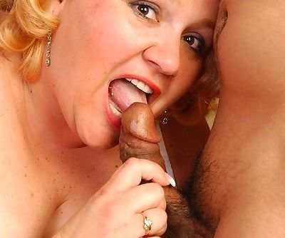 Older SSBBW Britany sucking dick during MMF threesome in stockings