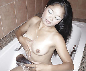 Filthy asian babe gives a blowjob and gets a huge load of jizz on her tits - part 2