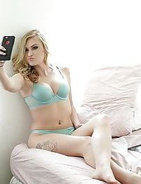 Teen babe Jessie Young caught taking lingerie self shots by voyeur