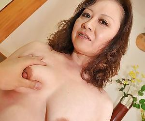 Asian of age lady strips nigh adjacent to an increment of gets her twat teased adjacent to a lovemaking toy