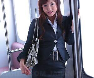 Pulchritudinous Japanese girl Mami Asakura opens her shirt all round puff her small tits