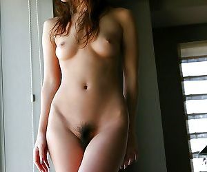 Well-graced asian girl with bushy cunt demonstrates her tempting loopings