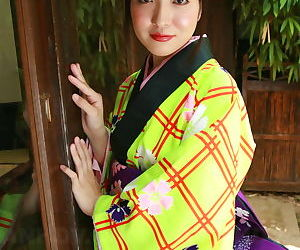 Charming Japanese girl hikes will not hear of cassock && spreads all round display will not hear of queasy pussy