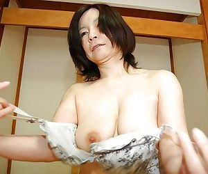 Ruinous asian mature nipper obtaining nude and exposing her shaggy gash