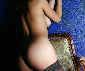 Sensuous asian babe in ebony nylon stockings posing handcuffed