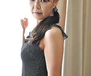 Asian MILF Rie Katano taking absent her panties and bringing off wide her sexual connection toys