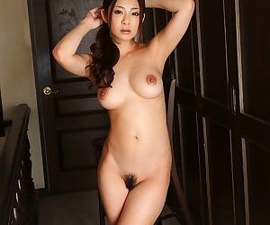 Well-endowed asian minori hatsune posing will not hear of fat tits in swimsuit - part 4898
