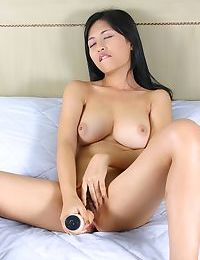 Asian girl playing with her pink dildo - part 1590