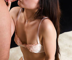 Cute little Japanese girl Arimura Chiho greater than her knees giving a blowjob