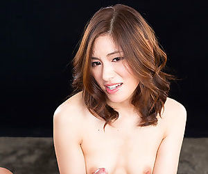 Beautiful Asian spread out on will not hear of knees giant hot handjob with epigrammatic tits showing