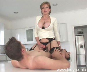 Milf in stockings lass sonia gets her pussy crushed and fucked - ornament 1292